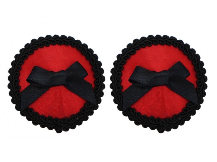 Roter Nippelschmuck mit schwarzer Schleife